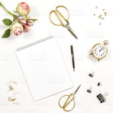 Sketchbook, flowers, office tools and accessories. Flat lay notebook, top view